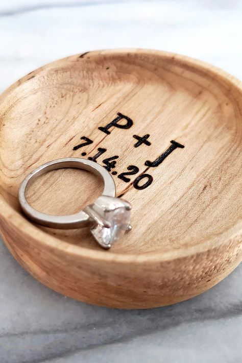 Keep your rings safe in a simple and meaningful wood ring dish. Handcrafted wood ring dishes are a one-of-a-kind, personalized way to keep your rings and other small jewelry safely stored and beautifully displayed. Personalized with two initials and a date, it's the perfect prop for wedding photos or makes a unique and modern engagement, wedding or anniversary gift.