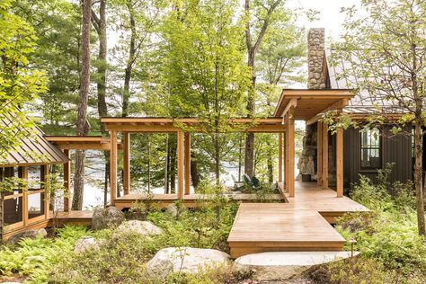 When designing Camp on Long Lake, Winkelman Architecture was inspired by the oak grove the home is nestled into. A covered walkway with views of the lake lightly tethers the kitchen, living room, and dining area to the bedroom. Concrete Walkway, Stone Walkway, Rock Walkway, Paver Walkway, Wood Patio, Little Italy, Architecture Portfolio, Architecture Design, Residential Architecture