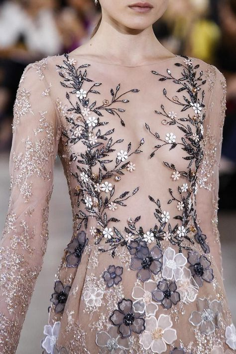 Lebanese designerGeorges Hobeikahas been a regular on the couture calendar since 2001 and he specialises in a traditional sort of elegant femininity: sparkles and florals and bows. It&r...