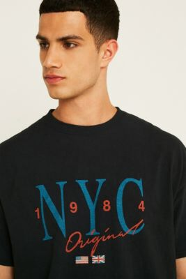 Check out UO NYC Washed Black T-Shirt from Urban Outfitters ddf9bb0a1d9