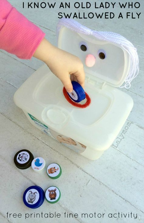 Book Activity for Kids: Free Printable Fine Motor Activity for Kids to play along with I Know an Old Lady Who Swallowed a Fly. Printable available on Lalymom.com - cute milk lids game!