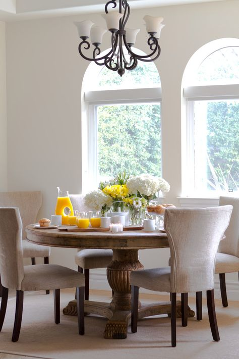 Prepossessing Pier One Kitchen Table Decor Ideas in Dining Room Traditional design ideas with Prepossessing arched window chandelier iron chandelier pedestal table reclaimed wood table round table