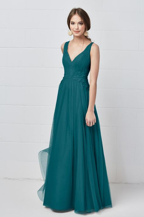 8bff8e150bef This lace and bobbinet bridesmaid dress features an A-line silhouette and a  sleeveless neckline, offering a smart and sophisticated style.
