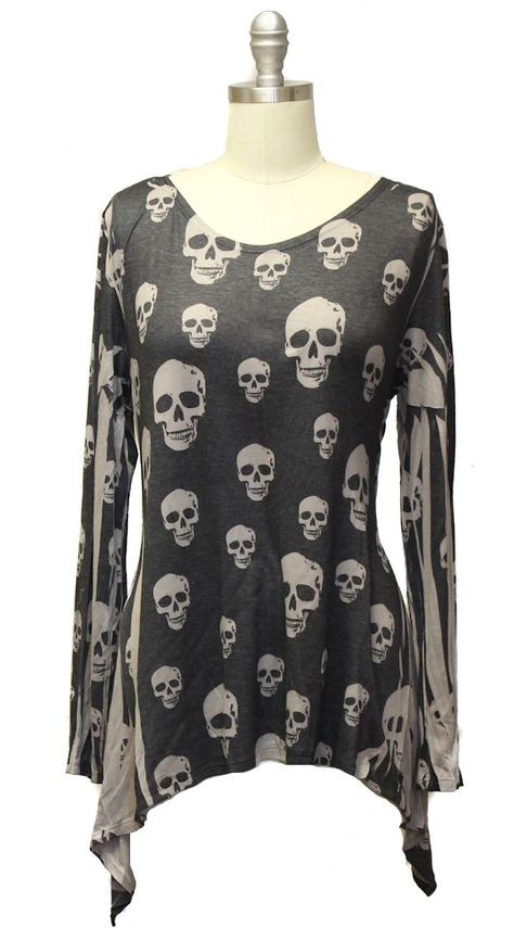During prohibition in the U.S, the government poisoned industrial alcohol, to discourage people from drinking it! It resulted in thousands of deaths. You took your life in your hands when you entered a speakeasy. Well, you'll only be taking fashion into your hands when you don this black and tan skull print top. It's alcohol free! The teetotallers would approve. 33%Rayon 64% polyester 6%Spandex Made in USA