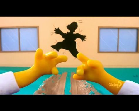 Homer looking at his hands realising he has become claymation