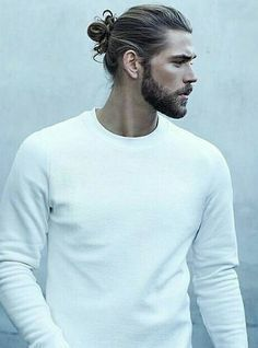 Hair Pulled Back Into Top Knot Ponytail Men S Hairstyle