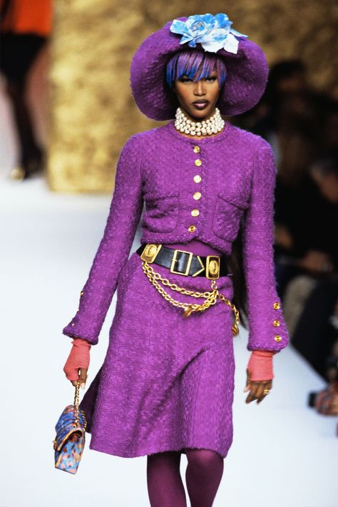 Harper's Bazaar Feb - Karl Lagerfeld's 100 Greatest Chanel Runway Moments: Bright purple had a moment on the couture runway in where Naomi Campbell sported a colorful wig to match,