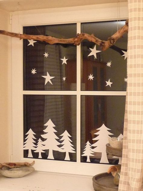 fir trees and stars from paper attached to the window