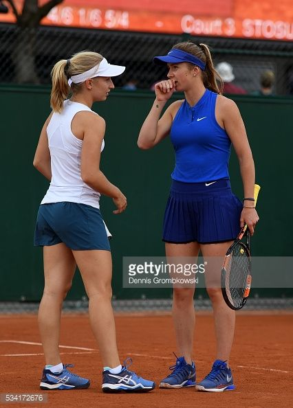 Daria Gavriolva of Australia talks with Elina Svitolina of Ukraine - double first