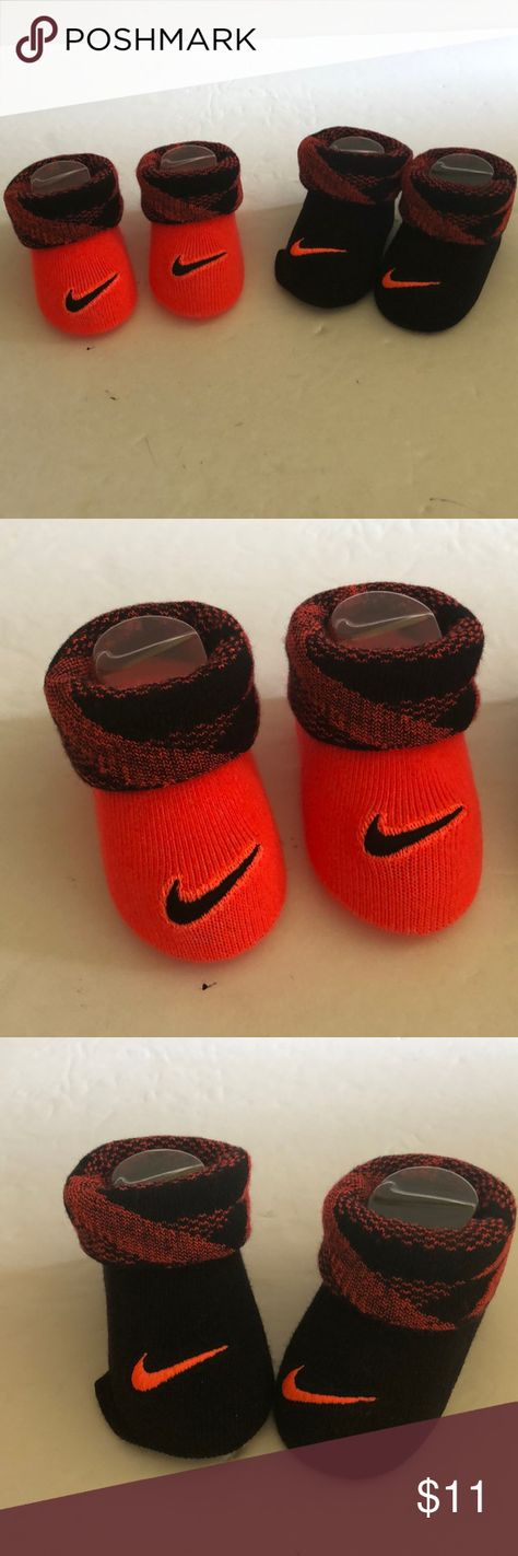 799f24a26f9b Nike Newborn infant Booties 0-6 months New in box. Never used. Orange with  black Nike logo and black with orange logo. 2 pairs Nike Other