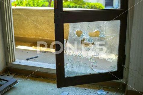 Broken glass door Stock Photo ~ Royalty Free Image #81141395