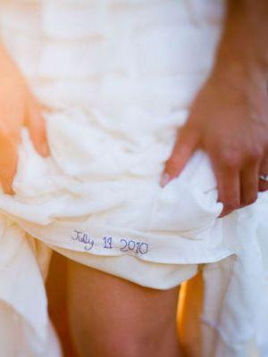 something blue. wedding date sewn into dress.