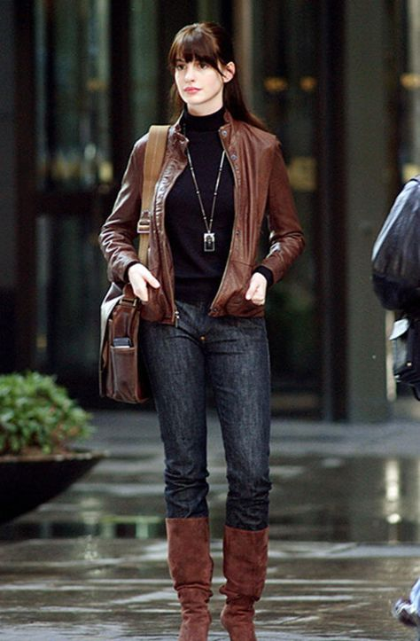 Chic Street Style: Anne Hathaway in 'The Devil Wears Prada', in jeans with black blouse, tan leather jacket and long boots. Street Jeans Fashion via
