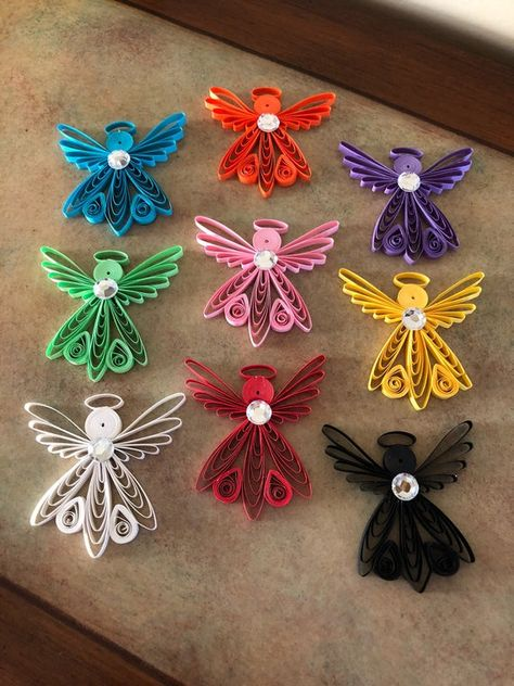 """Pretty little paper quilled Angels.... A little history about paper quilling.... """"During the Renaissance, French and Italian nuns and monks used quilling to decorate book covers and religious items. The paper most commonly used was strips of paper trimmed from the gilded edges of books. These gilded"""