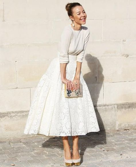 Love the all white outfit with the full lace skirt! It reminds me of the Dress the the character Judy from White Christmas wears when she gets engaged