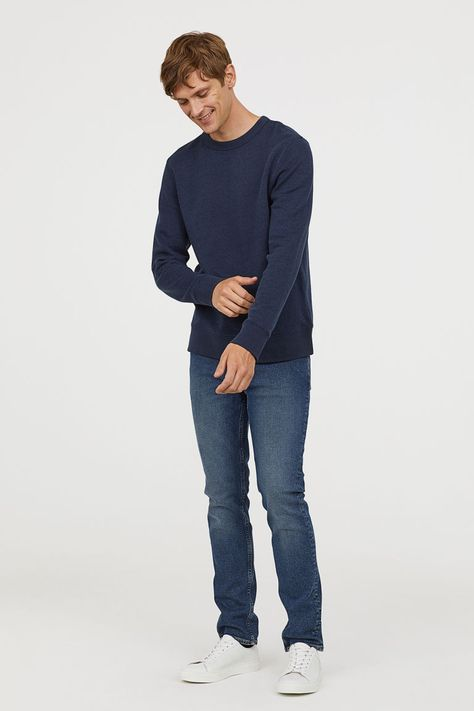 low-rise jeans in washed stretch denim with slim legs. The jeans are made partly from recycled cotton.