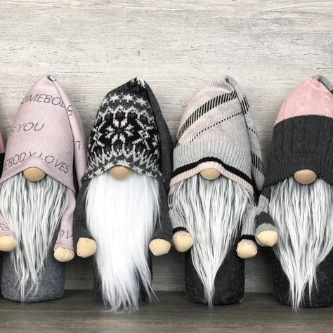 Handcrafted artisan gnomes in shades of pink and gray. #homedecor #pink #gray #pinkandgray #homedecor #handmade #handmadehomedecor #handcrafted #gnomes #tomte #nisse #farmhousedecor #farmhousestyle #farmhouselivingroom #artisan #neutral #neutraldecor #neutrallivingroomdecor