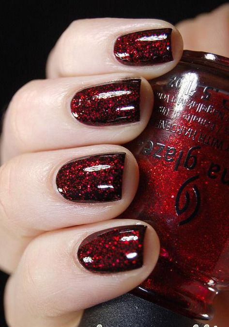 Black Nails with Red Glitter Coating.
