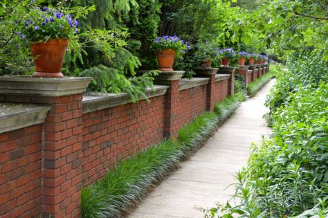 a gorgeous brick fence along a secluded path.