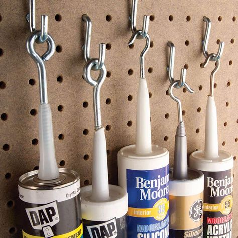 Hanging Caulk Tubes : Hanging Caulk Tubes We finally got the hang of preserving partially used caulk tubes from resourceful reader Stephen Hoke. Garage Workshop Organization, Garage Tool Storage, Workshop Storage, Garage Tools, Shed Storage, Diy Storage, Storage Organization, Storage Ideas, Lumber Storage