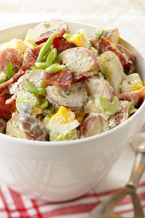 Potato salad is a summer barbecue classic, and our red potato salad with bacon is the perfect recipe for your Memorial Day gathering. #memorialdayideas #memorialdayparty #sidedishideas #partysidedish #bhg
