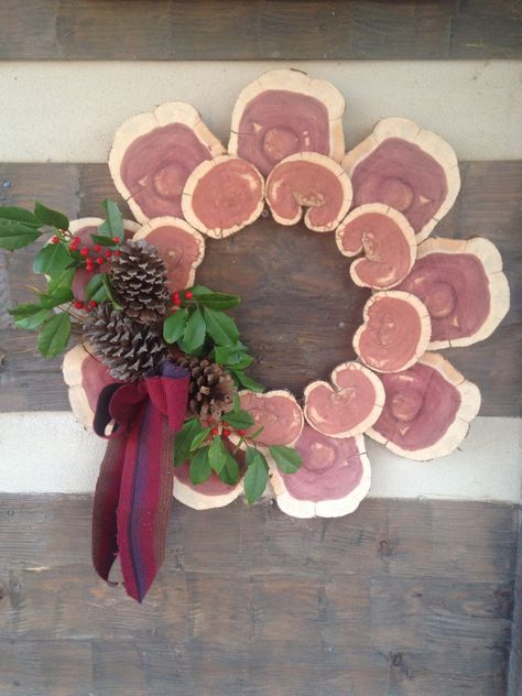 Cedar log Christmas wreath with pine cones