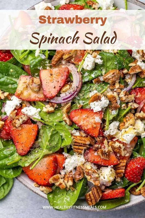 This Strawberry Spinach Salad Recipe is a hearty and delicious healthy salad loaded with flavor and perfect to enjoy all year long. #spinachsalad #healthysalad #strawberrysalad via @healthyfitnessmeals