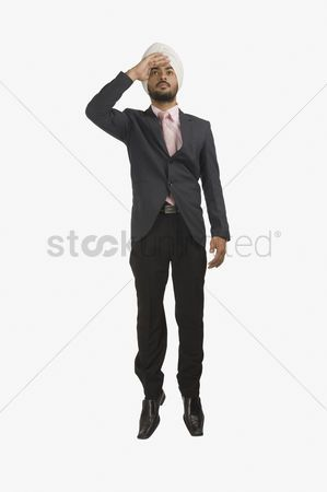 Businessman Looking Away With Shielding His Eyes Stock Photo