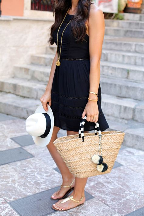 LBD in Sicily Kat Tanita of With Love From Kat wears a Sam Edelman little black summer dress with Sam Edelman Gigi sandals, a Kayu bag, and panama hat in Taormina Sicily.