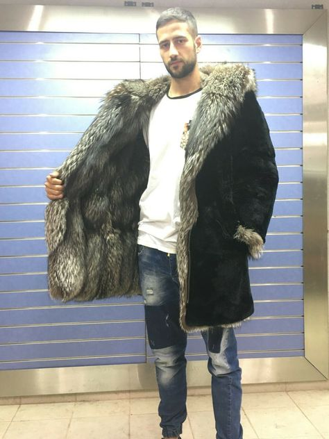 In This model, we use Top Quality Silver Fox Fur full skins in unique natural color pattern and combine them with rich satin lining and hood. It's real fur.