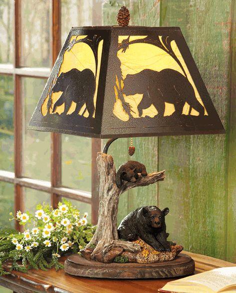 Black Bear Cabin Lamp - A metal art bear shade tops the detailed polyresin Black Bear Cabin Lamp featuring a mama black bear and cub. Uses one 40-watt max bulb. Measures 12 1/2