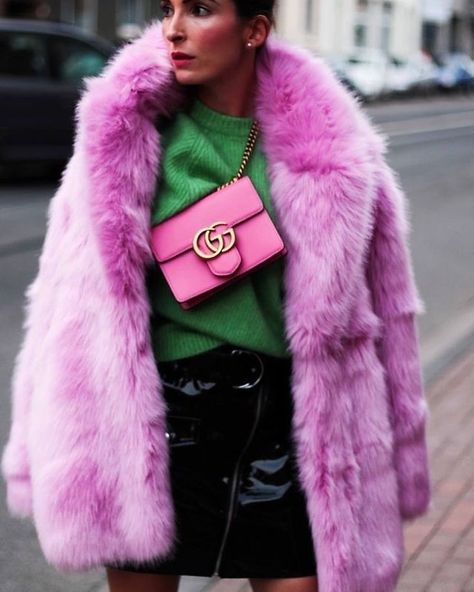 Pink fuzzy coat and pink Gucci bag with emerald green top and black skirt. The Best Street Style Inspiration & More Details That Make the Difference.