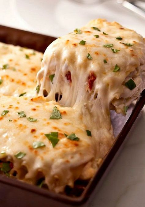 Creamy White Chicken & Artichoke Lasagna ~ You may never make regular lasagna again after trying this one—with shredded chicken, sun-dried tomatoes and artichokes in a rich, creamy white sauce.. :)