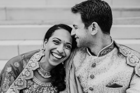 Candid Chicago Indian wedding photo of bride and groom laughing together