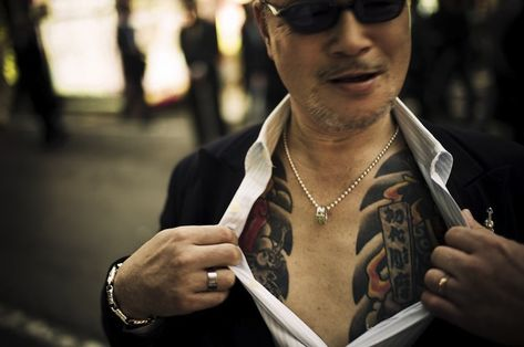 After months of painful negotiations, Belgian photographer Anton Kusters spent two years with one of Japan's most notorious Yakuza gangs. For those unfamiliar with the Yakuza, they are known for their brutality, tattoos and strict code of honor. After gaining exclusive access, Kusters captured never-before-seen moments from their business meetings, bath houses, night clubs, and even funerals.