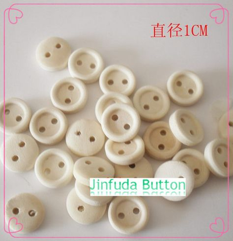 Packet 10 x Pale Cream Wood 13mm Round 4-Holed Sew On Buttons HA10765