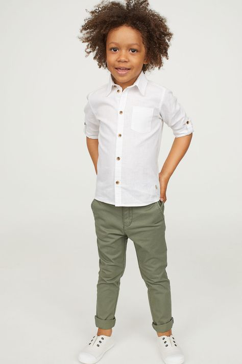 Chinos in cotton fabric with an adjustable elasticized waistband and zip fly with button. Side pockets and mock welt back pockets with button.