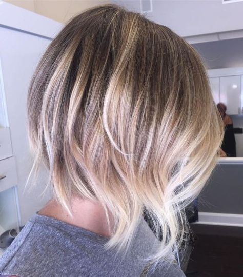 Inverted Bob Cut for Fine Hair-Add some interest to your straight bob with an inverted cut. Shorter at the back and longer at the front, the sharp angles will give your hair a bit more volume and dynamics. Plus, a slight bend and curl at the ends create a feminine touch. This bob proves that short hair can be just as sexy as long locks.