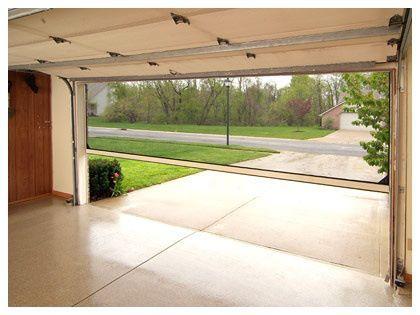 Retractable screen door on garage door. Great idea!