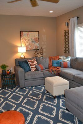 Omaha Interior Design, gray, blue and orange living room. This is nice. I  wouldn't have thought about tan walls and a gray couch.