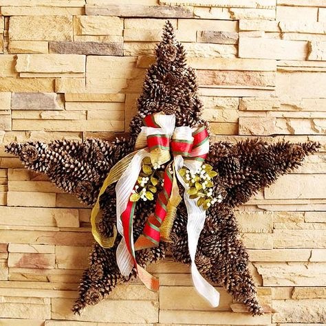 With some pinecones, ribbons and berry sprigs, you can make this stunning wreath from cardboard cutout to completely dazzling! http://www.bhg.com/christmas/wreaths/pretty-christmas-wreaths/?socsrc=bhgpin122114pineconestarwreath&page=28