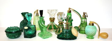 green perfume bottles and atomizers