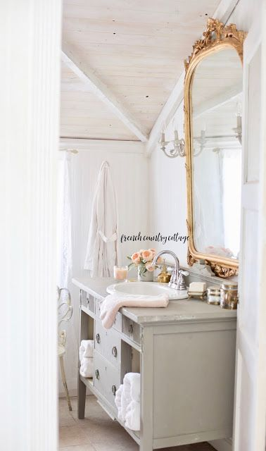 7 Ways To Add French Farmhouse Charm To Your Bathroom In 2020 French Farmhouse French Country Cottage Bathroom Lighting Design