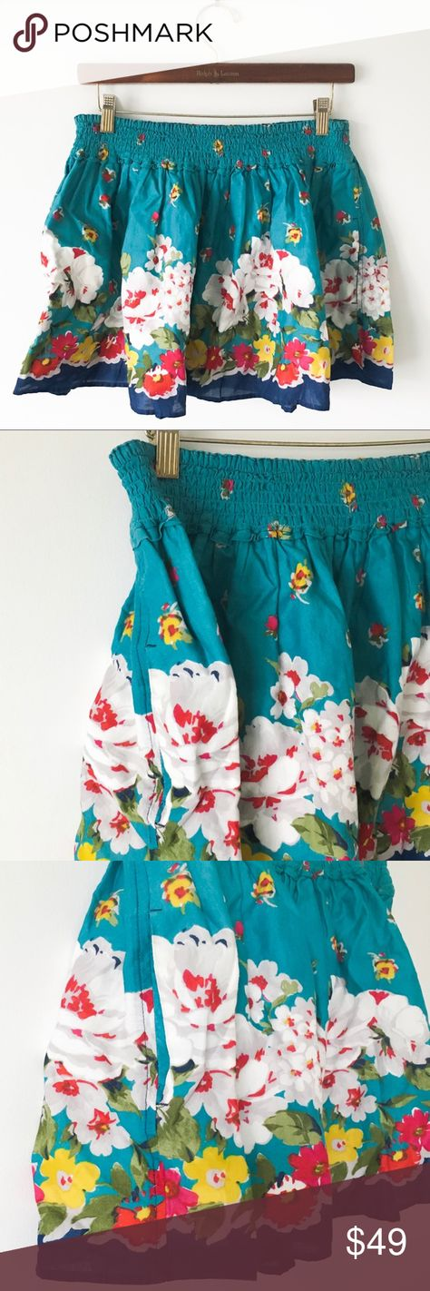 Vintage Hollister Floral Skirt Vintage Hollister California summer/skater a-like skirt. Floral print. Aqua/turquoise and dark blue/indigo with white, red, yellow, and pink flowers and green leaves. White slip underneath. Elasticized waistband. Vertical side hand pockets. Vibrant, flowy, and beautiful. Like-new condition. 100% cotton. Hollister Skirts A-Line or Full