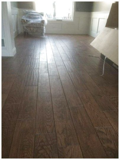 One Trick To Avoid Making Your Floors Look Less Like Tile Is To Stagger The Tile Size And Placement See My Pi Wood Look Tile Floor Porcelain Flooring Flooring