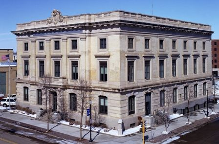 Ronald N. Davies Federal Building & U.S. Courthouse: Construction of the Ronald N. Davies Federal Building Court House was originally completed in 1906, and a large expansion to the east was completed in 1936. It is one of the earliest monumental civic structures in Grand Forks.  The building was designed in the Beaux Arts style and incorporates balustrades, cornices, pilasters, and lavish decorations.