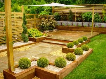 garden design with sleepers. new oak sleepers and sandstone paving combine to provide a stylish garden for this kent home in the pinterest design with w