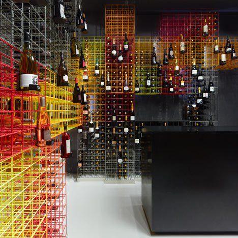 Furch Gestaltung + Production used rainbow-coloured crates to store wine bottles inside the Weinhandlung Kreis wine shop in Stuttgart.