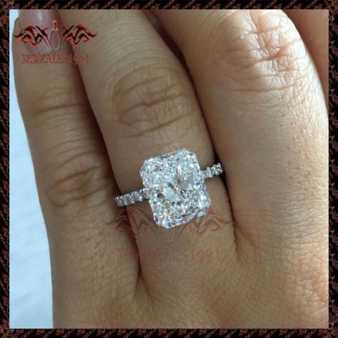 I love radiant cut, LOVE rectangular diamond with delicate pave band. ANNA is a handcrafted Jean Dousset solitaire engagement ring with one row of diamonds on the band and pictured with a Radiant cut diamond in Platinum.