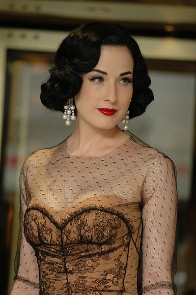 """Glamour, beauty and sensuality in one person: Dita Von Teese. The """"queen of burlesque revival"""". Graceful and talented Dita is not only a dancer, she is a one-woman show and style icon."""
